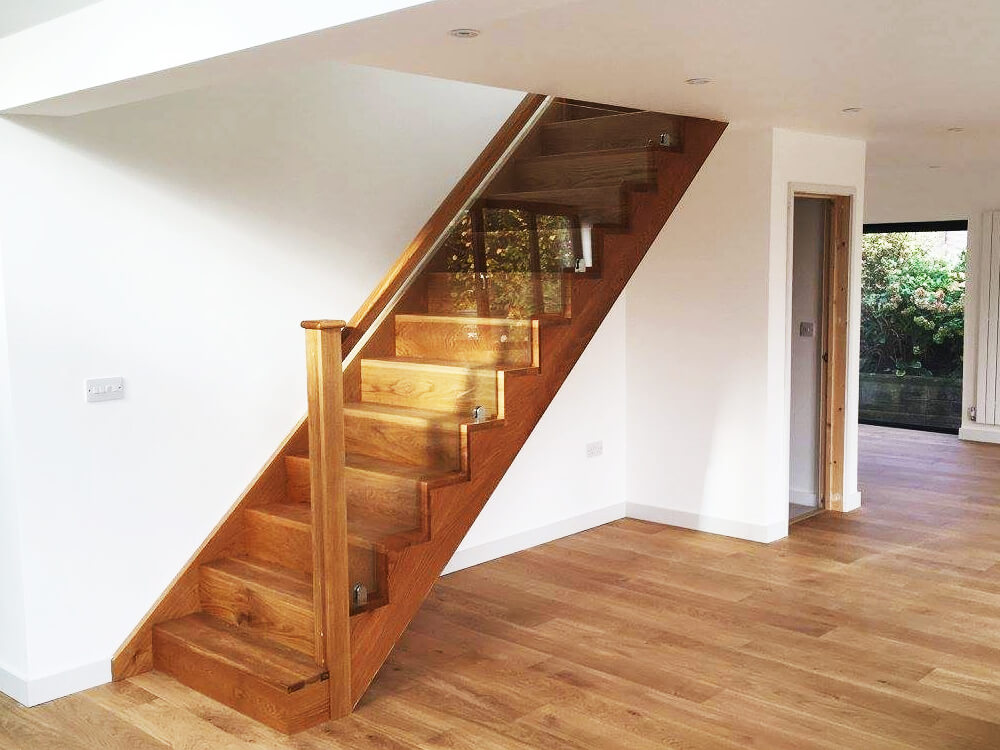 wooden staircase with glass walls
