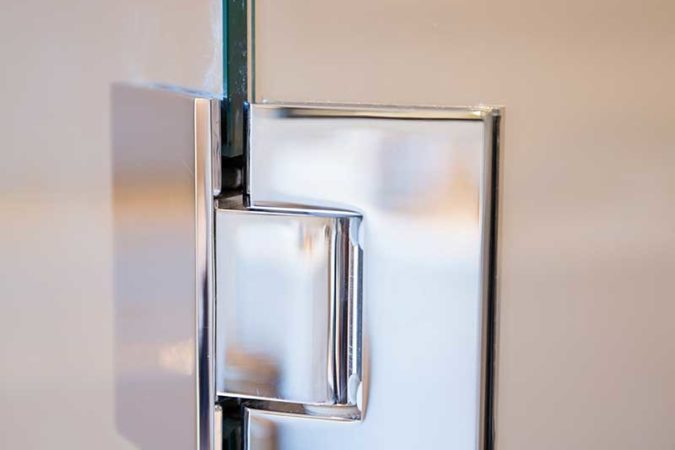 Glass shower enclosure clamp
