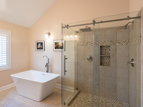 frameless glass sliding shower doors in a beautiful and neat bathroom